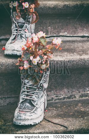 Old Boots With Flowers As Element Of Garden Design. Selective Focus.