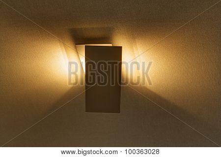 Modern sconce on the wall providing a beautiful soft light