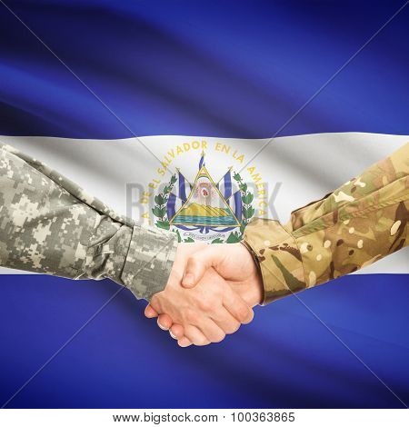 Men In Uniform Shaking Hands With Flag On Background - El Salvador