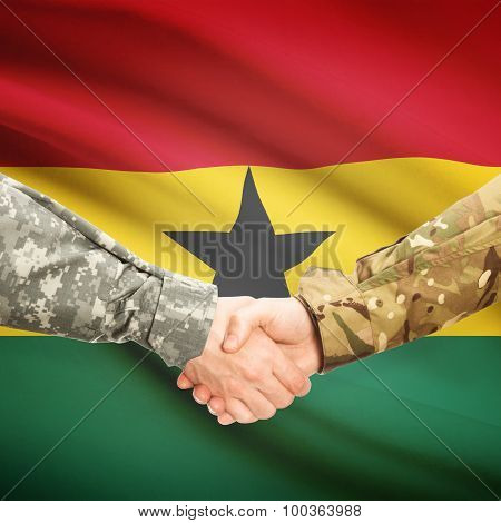 Men In Uniform Shaking Hands With Flag On Background - Ghana