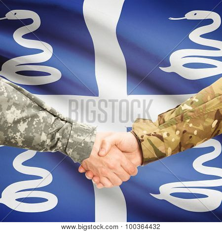 Men In Uniform Shaking Hands With Flag On Background - Martinique