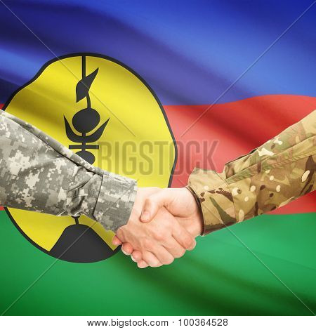 Men In Uniform Shaking Hands With Flag On Background - New Caledonia