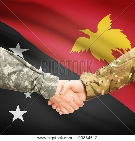 Men In Uniform Shaking Hands With Flag On Background - Papua New Guinea
