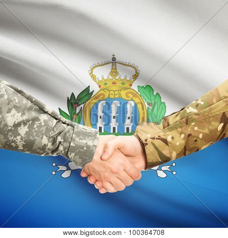 Men In Uniform Shaking Hands With Flag On Background - San Marino
