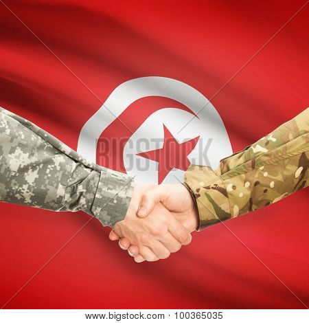 Men In Uniform Shaking Hands With Flag On Background - Tunisia
