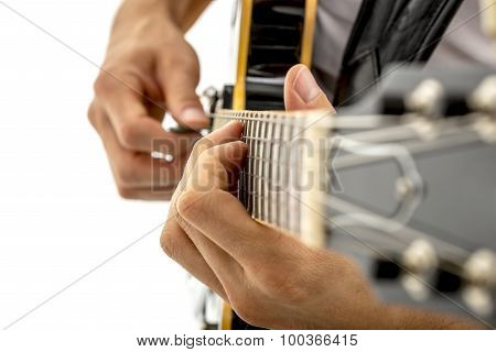 Man Strumming A Guitar