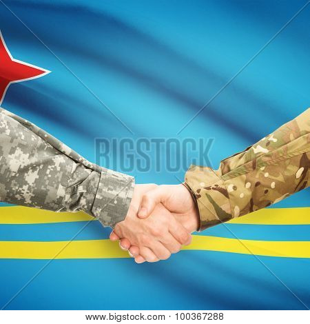 Men In Uniform Shaking Hands With Flag On Background - Aruba