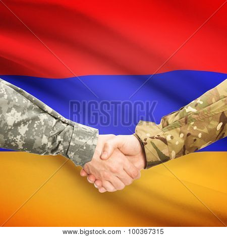 Men In Uniform Shaking Hands With Flag On Background - Armenia