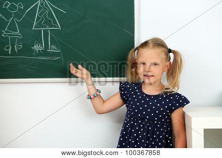 Girl drawing on blackboard, close-up