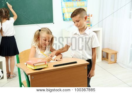 Portrait of happy pupils at lesson