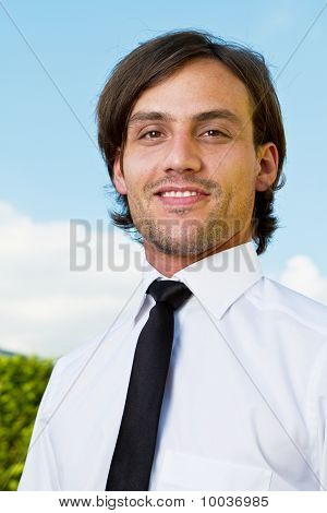 Young Business Man Over Blue Sky