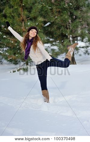Girl Playing With Snow In Park. Winter Fun, Joy And Winter Vacation Concept