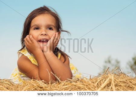 Little Girl Lying On A Haystack