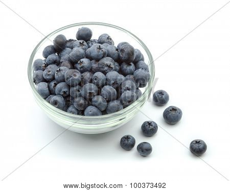 ripe blueberries in bowl isolated on white.