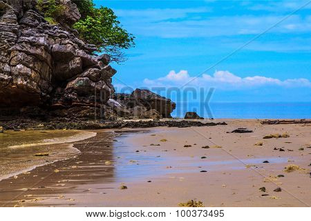 Rest of the Andaman Sea. Rocks of the island in the shallow waters and beautiful beaches with fine yellow sand