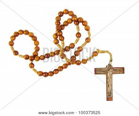 Wooden rosary beads and cross isolated on a white background