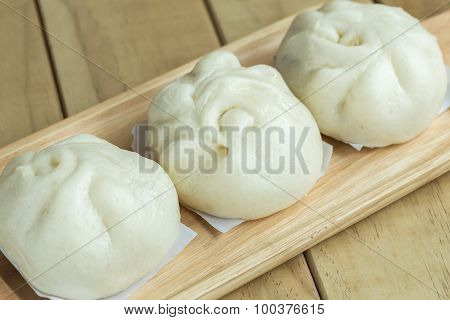 White Steamed Buns On Wooden Tray