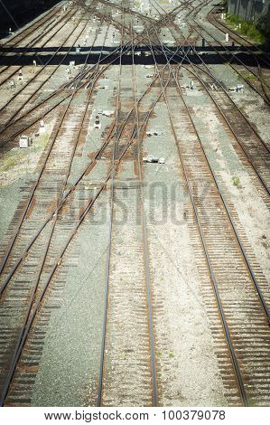 High angle view looking down on rusty railroad tracks, filtered high contrast.