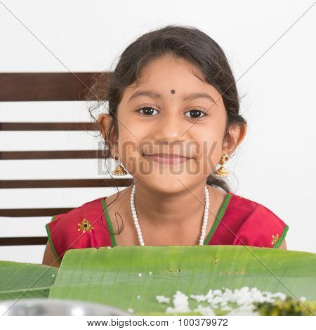 Indian family dining at home. Photo of Asian child eating rice. India culture.