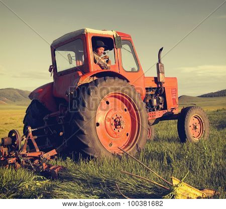 Mongolian Farmer Driving Tractor Field Agricultural Concept