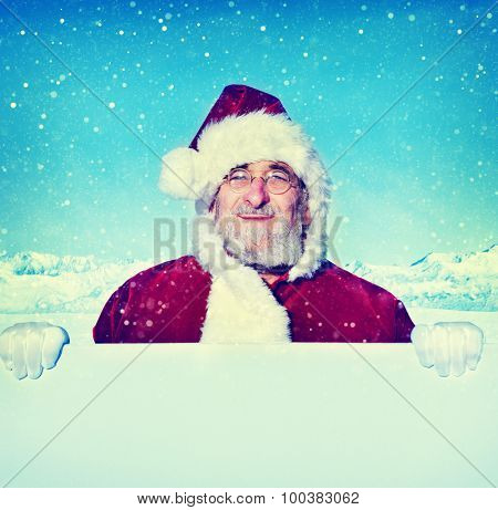 Santa Claus Holding a Blank Sign Snowing Concept