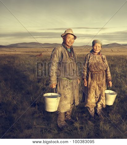 Mongolian Couple Farmers Holding Basin Posing Field Concept
