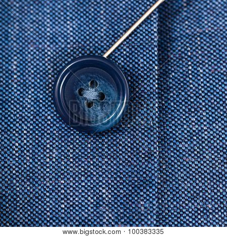 Attaching Of Button To Blue Silk Cloth By Needle