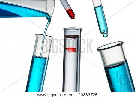 Pouring reagent into test tube
