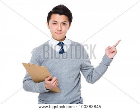 Businessman hold clipboard and finger point up
