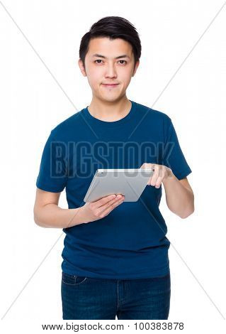 Asian young man use of the digital tablet