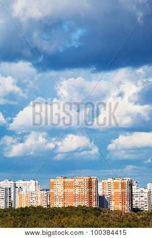 Blue And White Low Clouds Over Apartment Buildings