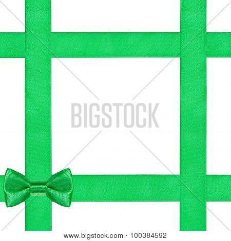 Green Bow Knot On Four Satin Ribbons Isolated