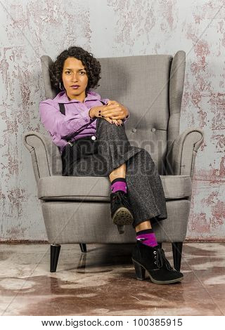 Mulatto girl in purple and trousers.