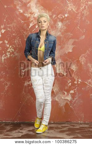 Blonde girl in jeans and a beautiful linen