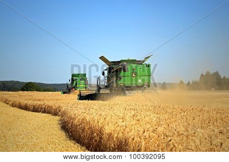 Two John Deere Modern Combines Harvest Barley