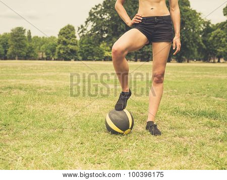 Woman In Park With Medicine Ball