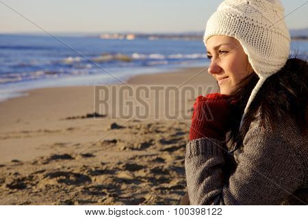 Smiling Woman With Hat Looking Ocean In Winter