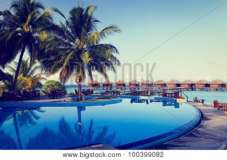Tropical resort swimming pool and cafe bar