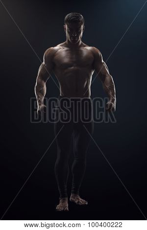Confident Young Fitness Man Dramatic Concept Photo