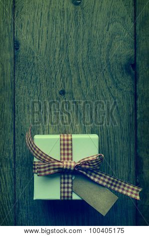 Cross Processed Gift Box On Wood From Above