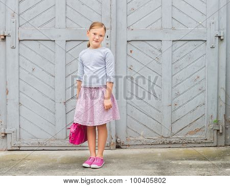 Fashion portrait of a cute little girl of 8 years old