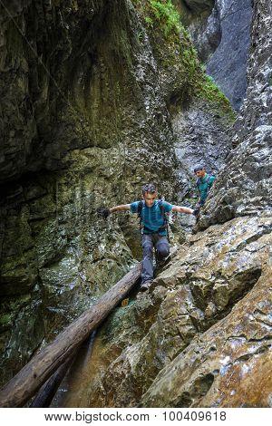 Two Men Hiker Walking In A Canyon