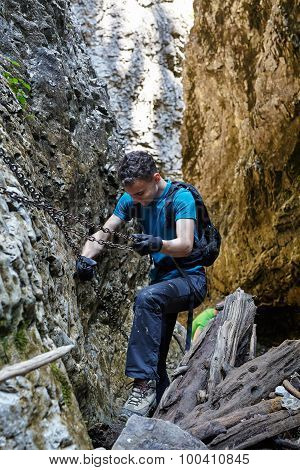 Teenager Hiker Climbing In A Canyon