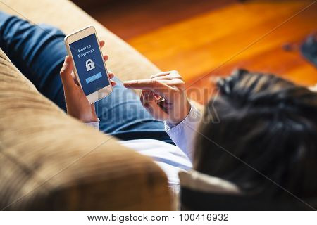Woman Using Mobile For Payment At Home. Blue Screen.