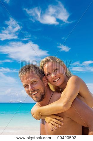 Happy young couple on the beach in the summer time