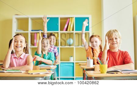 Cute schoolchildren working at lesson