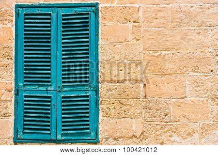 blue wooden window in Mdina, Malta