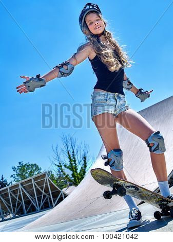 Teen skateboarding his skateboard outdoor. Girl do  stunt .