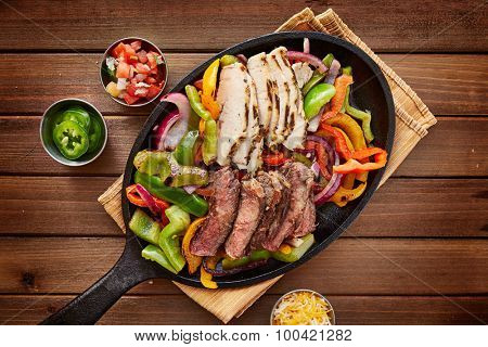 rustic fajita skillet meal with steak and chicken