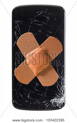 modern smartphone with cracked screen in one corner healed with band aid, isolated on white background